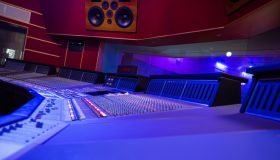 Mixing Audio Control Panel, High Power Speakers And View Through Soundproof Window On Musicians